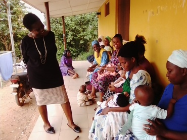 Dr Temitayo interacts with  mothers nterwho came to immunize their children at Ogede Community Health Ce